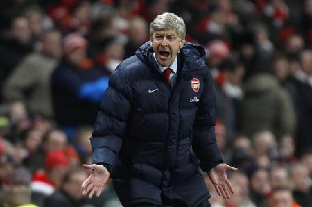 Arsenal's manager Arsene Wenger reacts during their English Premier League soccer match against Manchester United at the Emirates Stadium in London
