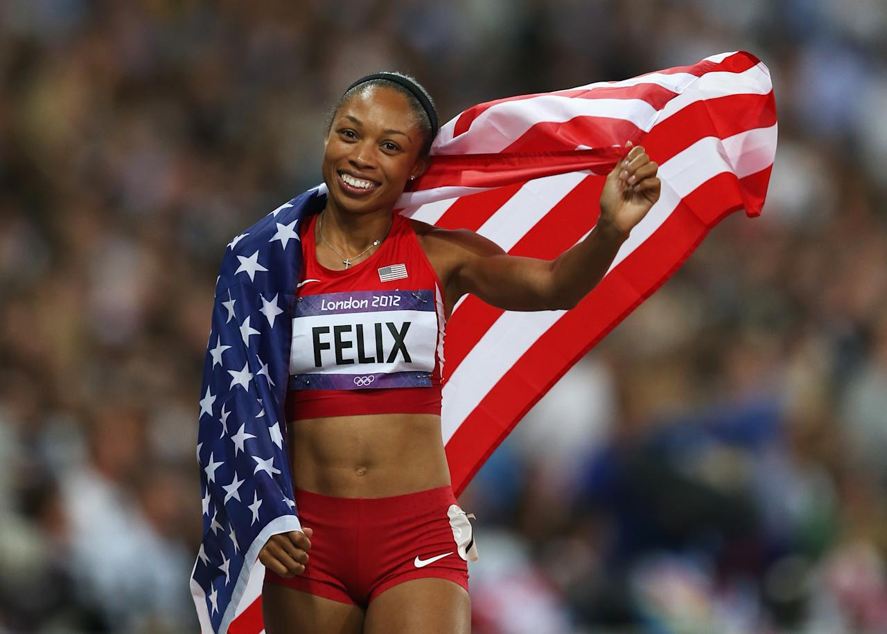 LONDON, ENGLAND - AUGUST 08:  Allyson Felix of the United States celebrates after winning gold in the Women's 200m Final on Day 12 of the London 2012 Olympic Games at Olympic Stadium on August 8, 2012 in London, England.  (Photo by Quinn Rooney/Getty Images)