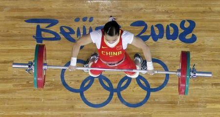 Chen Xiexia of China competes in the women's 48kg Group A snatch weightlifting competition at the Beijing 2008 Olympic Games August 9, 2008.     REUTERS/Yves Herman