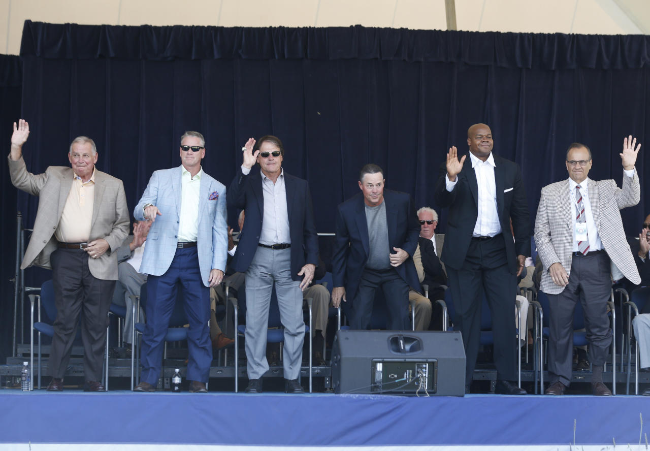 Baseball Hall of Fame electees Bobby Cox, Tom Glavine, Tony La Russa, Greg Maddux, Frank Thomas and Joe Torre are introduced during an awards ceremony at Doubleday Field on Saturday, July 26, 2014, in Cooperstown, N.Y. They will be inducted on Sunday. (AP Photo/Mike Groll)