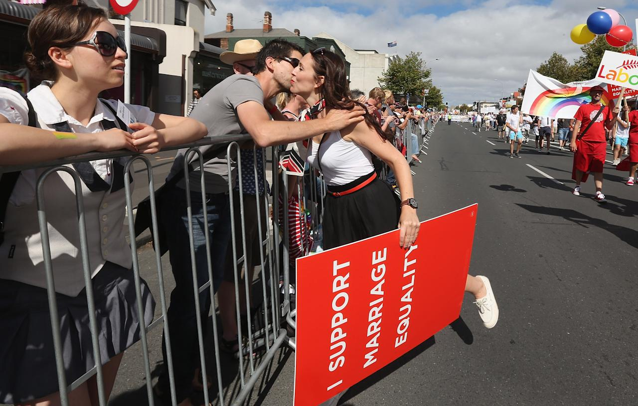 AUCKLAND, NEW ZEALAND - FEBRUARY 16: Jacinda Ardern, Labour list MP participates in the parade down Ponsonby Road during the Pride parade on February 16, 2013 in Auckland, New Zealand. The gay parade, celebrating lesbian, gay, bisexual and transgender (LGBT) culture has returned to Ponsonby Road after 10 years and organisers plan to put the parade on the tourism map, in the style of the Sydney Mardi Gras.  (Photo by Sandra Mu/Getty Images)