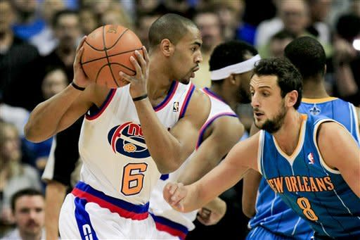 Denver Nuggets shooting guard Arron Afflalo (6) tries to find a way around New Orleans Hornets shooting guard Marco Belinelli (8) during the first quarter of an NBA basketball game Friday, March 9, 2012 in Denver. (AP Photo/Barry Gutierrez)