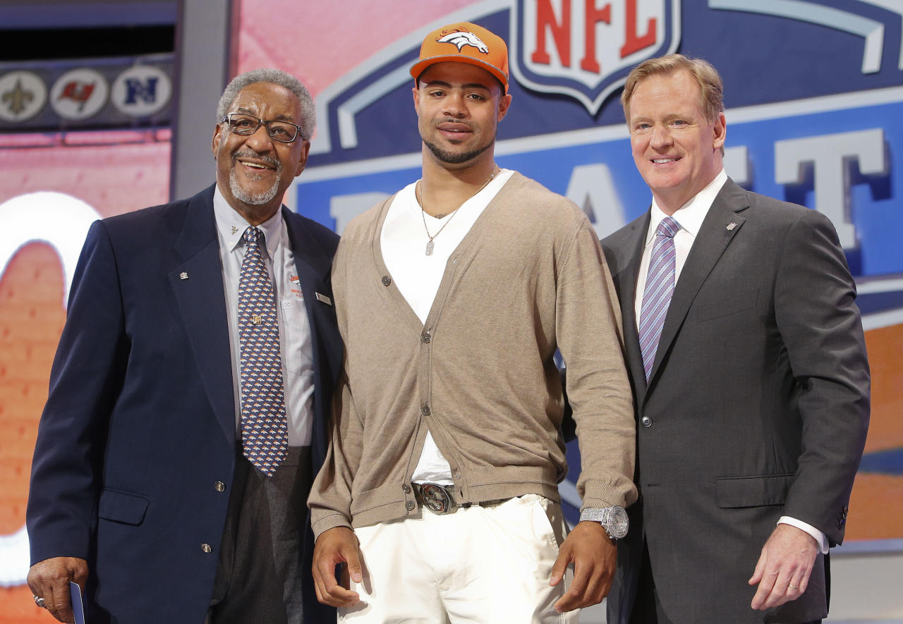 Indiana wide receiver Cody Latimer poses for photos with NFL commissioner Roger Goodell, right, and former Denver Broncos halfback Gene Mingo after being selected by the Denver Broncos as the 56th pick during the second round of the 2014 NFL Draft, Friday, May 9, 2014, in New York. (AP Photo/Jason DeCrow)