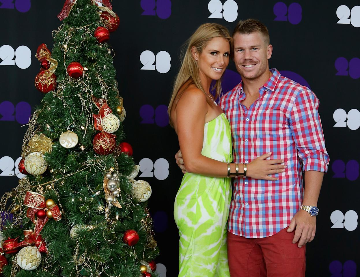 MELBOURNE, AUSTRALIA - DECEMBER 25:  David Warner of Australia and his partner Candice Falzon pose ahead of the Cricket Australia Christmas Day Lunch at Crown Metropol on December 25, 2013 in Melbourne, Australia.  (Photo by Scott Barbour/Getty Images)