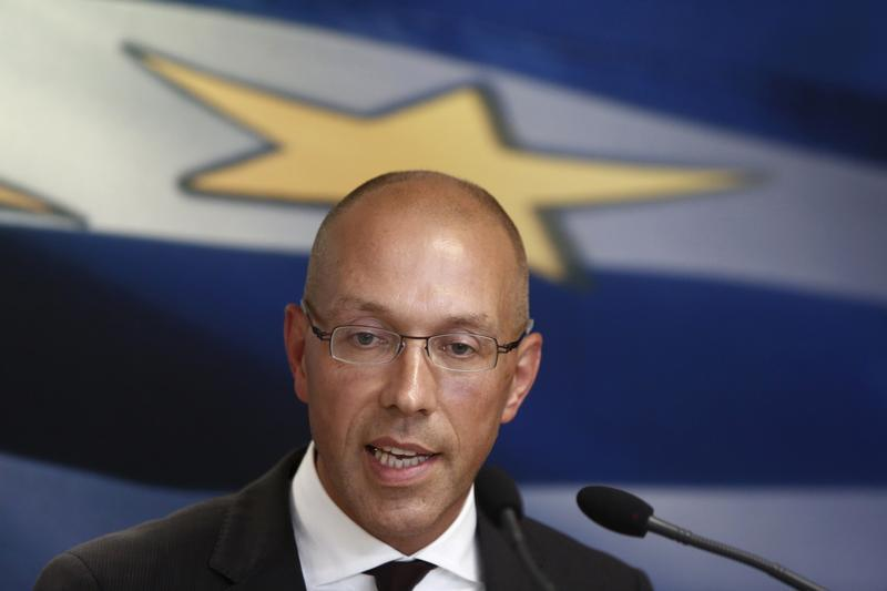 ECB executive board member Asmussen addresses reporters in Athens