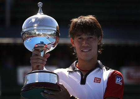 Nishikori of Japan holds the trophy after winning the final against Berdych of the Czech Republic at the Kooyong Classic tennis tournament in Melbourne