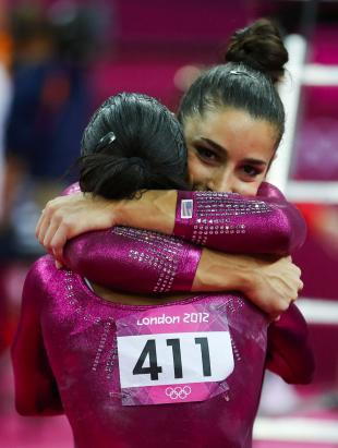 Aly Raisman, right, embraces Gabby Douglas, who won the all-around gold medal. (Reuters)