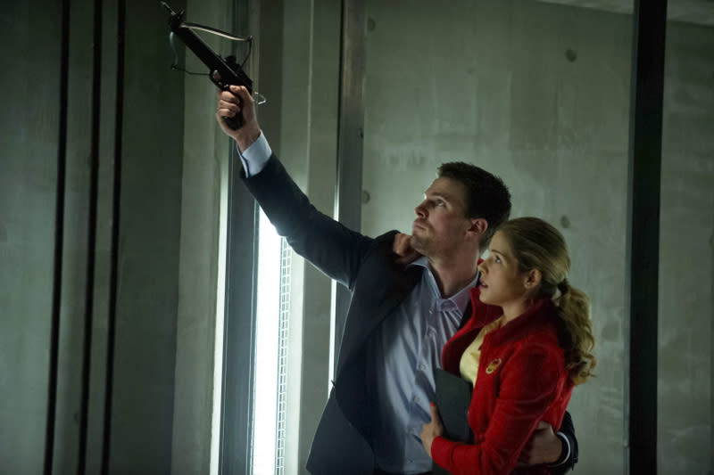 """""""Darkness on the Edge of Town"""" -- Stephen Amell as Oliver Queen and Emily Bett Rickards as Felicity Smoak"""