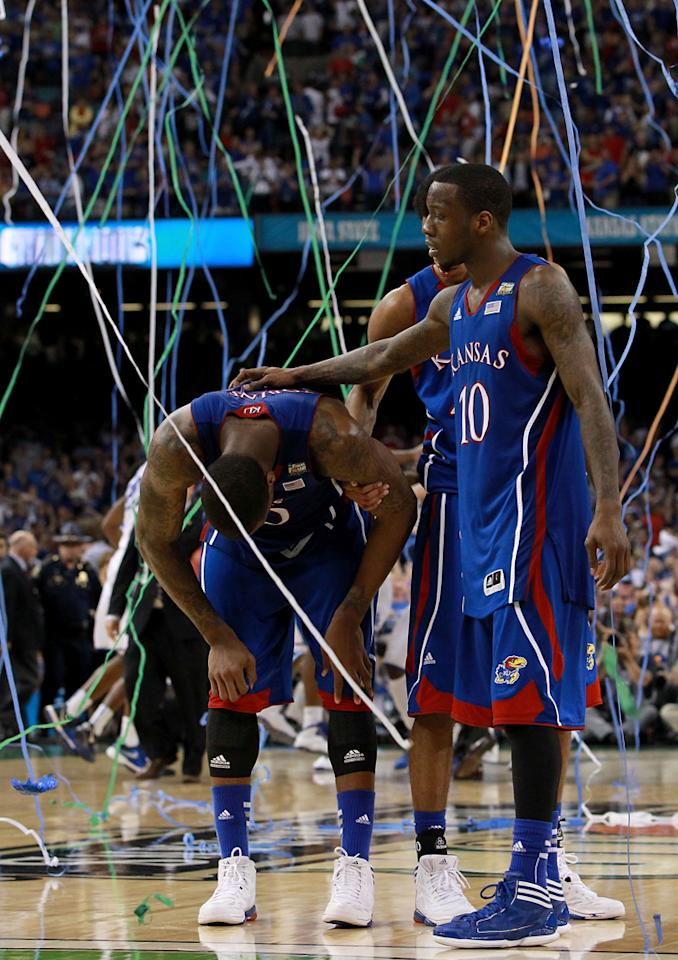 Thomas Robinson #0 and Tyshawn Taylor #10 of the Kansas Jayhawks react after losing to the Kentucky Wildcats 67-59 in the National Championship Game of the 2012 NCAA Division I Men's Basketball Tournament at the Mercedes-Benz Superdome on April 2, 2012 in New Orleans, Louisiana. (Photo by Ronald Martinez/Getty Images)