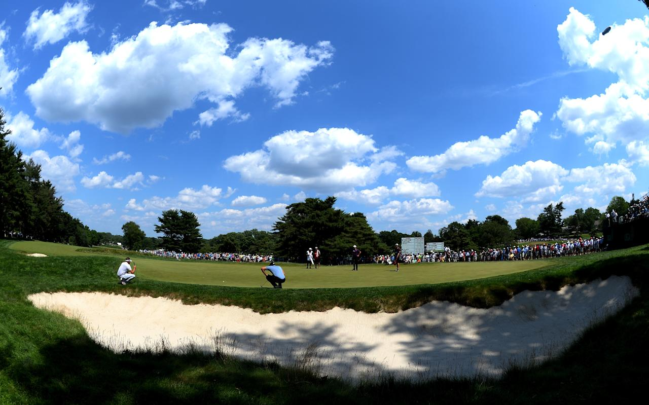 ARDMORE, PA - JUNE 15:  Ian Poulter of England, Mathew Goggin of Australia and Henrik Stenson of Sweden are seen on the second green during Round Three of the 113th U.S. Open at Merion Golf Club on June 15, 2013 in Ardmore, Pennsylvania.  (Photo by Ross Kinnaird/Getty Images)
