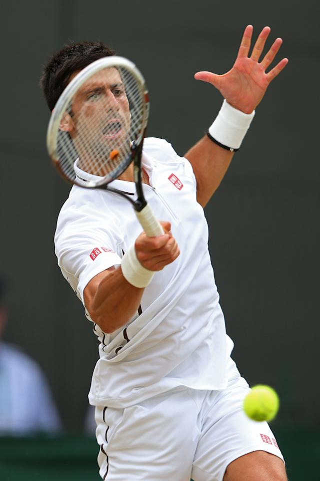 LONDON, ENGLAND - JULY 03: Novak Djokovic of Serbia plays a forehand during the Gentlemen's Singles quarter-final match against Tomas Berdych of Czech Republic on day nine of the Wimbledon Lawn Tennis Championships at the All England Lawn Tennis and Croquet Club at Wimbledon on July 3, 2013 in London, England. (Photo by Julian Finney/Getty Images)