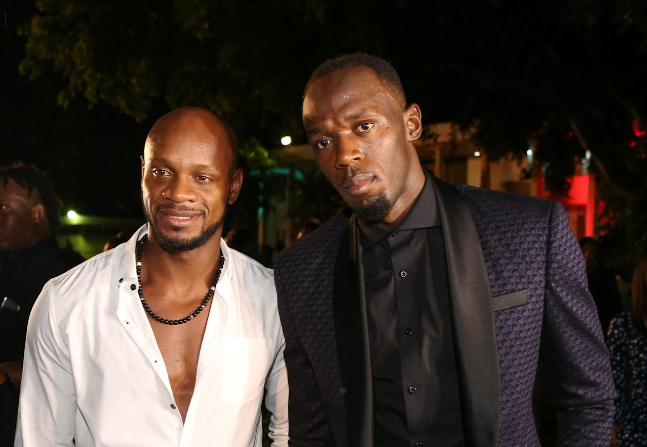 REFILE - CORRECTING TYPO  Jamaican Olympic gold medallist Usain Bolt (R) and fellow athlete Asafa Powell pose for a photograph during a reception at the residence of Jamaica's Prime Minister Andrew Holness (not pictured) in Kingston, Jamaica, October 14, 2016. Picture taken October 14, 2016. REUTERS/Gilbert Bellamy