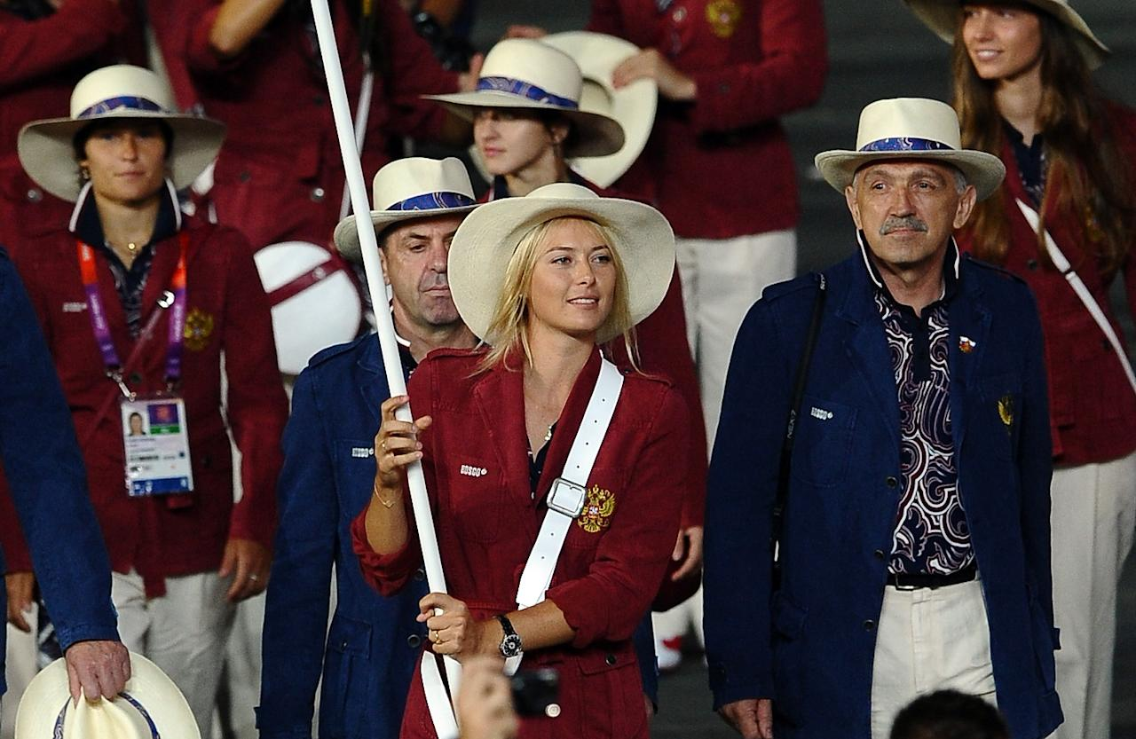 LONDON, ENGLAND - JULY 27:  Maria Sharapova of the Russia Olympic tennis team carries her country's flag during the Opening Ceremony of the London 2012 Olympic Games at the Olympic Stadium on July 27, 2012 in London, England.  (Photo by Laurence Griffiths/Getty Images)
