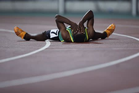 Zambia's Siame celebrates winning the men's 100m at the 2014 Nanjing Youth Olympic Games in Nanjing