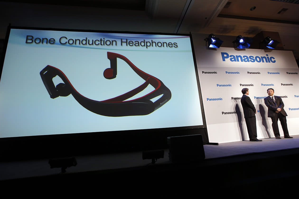Panasonic's Shiro Kitajima, far right, and Vic Carlson, introduces the bone construction headphones during a news conference at the International Consumer Electronics Show. The headphones connect to a TV via the Bluetooth wireless standard and attach to your head like a normal set of headphones. But instead of using your ears, the headphones work like hearing aids by transmitting sound waves through your skull.