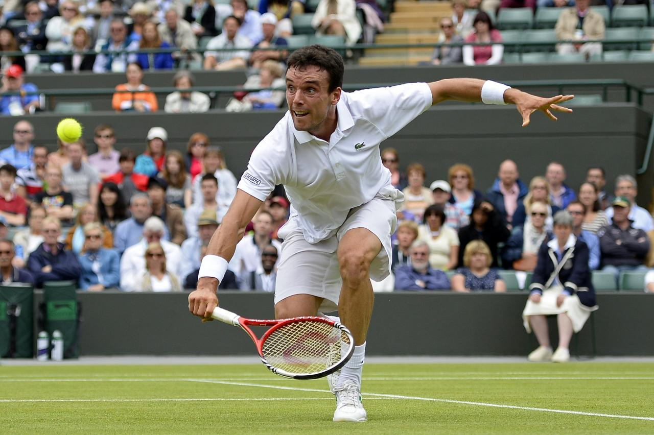 LONDON, ENGLAND - JUNE 28: Roberto Bautista Agut of Spain volleys during his Gentlemen's Singles second round match against David Ferrer of Spain on day five of the Wimbledon Lawn Tennis Championships at the All England Lawn Tennis and Croquet Club on June 28, 2013 in London, England. (Photo by Dennis Grombkowski/Getty Images)