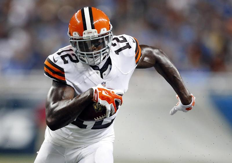 In this Aug. 9, 2014, file photo, Cleveland Browns wide receiver Josh Gordon (12) runs with the ball  in the first half of a preseason NFL football game against the Detroit Lions at Ford Field in Detroit. A person familiar with Gordon's situation says the suspended wide receiver wants to play in the Canadian Football League, but is prohibited from doing so. Under CFL rules, a player suspended by the NFL and under contract is not eligible to play in Canada. But if the Browns released Gordon, he would be able to play elsewhere