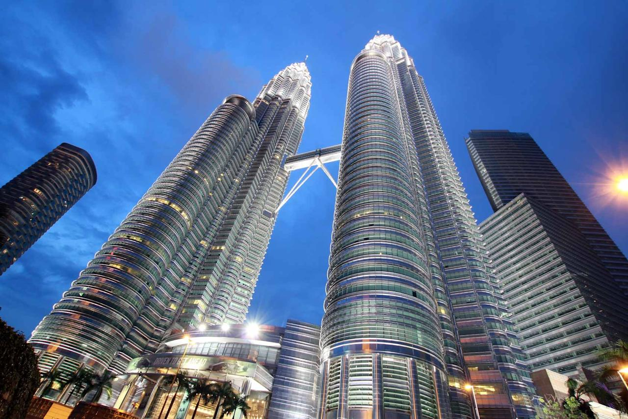 The Petronas Towers would definitely be contenders for this accolade. Located in Kuala Lumpur, these twin towers stand 88 storeys high (8 represents prosperity in Asia) and held the record for the world's tallest building between 1998 and 2004, before the Taipei 101 tower was built. Although no longer the tallest buildings, they remain the tallest twin towers ever built.