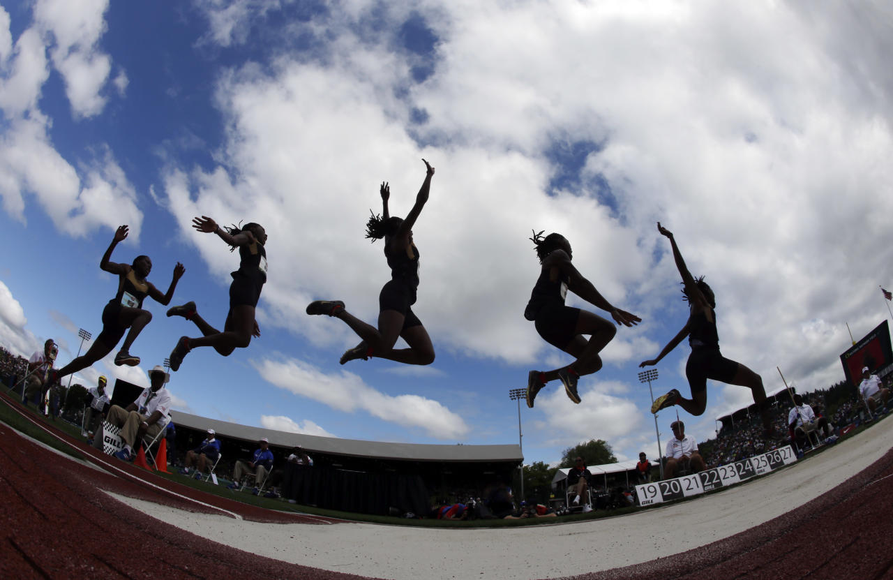 In this multiple exposure frame, Brittney Reese competes in the women's long jump final at the U.S. Olympic Track and Field Trials Sunday, July 1, 2012, in Eugene, Ore. (AP Photo/Charlie Riedel)