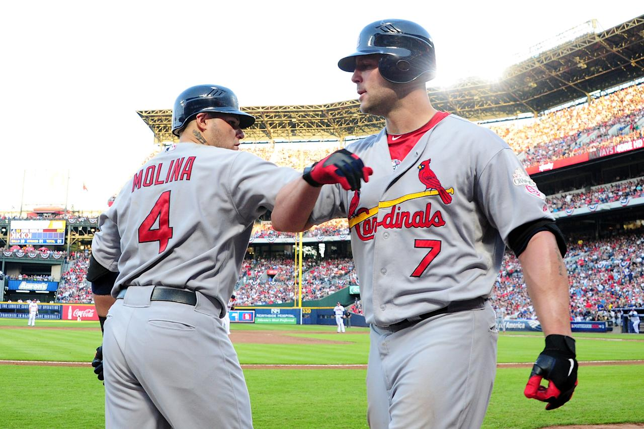 ATLANTA, GA - OCTOBER 05:  Matt Holliday #7 of the St. Louis Cardinals celebrates with Yadier Molina #4 after hitting a solo home run in the sixth inning against the Atlanta Braves during the National League Wild Card playoff game at Turner Field on October 5, 2012 in Atlanta, Georgia.  (Photo by Scott Cunningham/Getty Images)