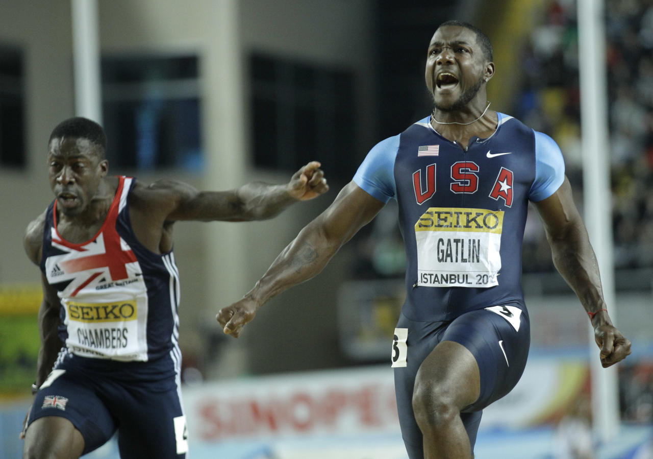 United States' Justin Gatlin celebrates winning the Men's 60m final during the World Indoor Athletics Championships in Istanbul, Turkey, Saturday, March 10, 2012. Left is Britain's Dwain Chambers. (AP Photo/Matt Dunham)