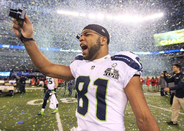 Seattle Seahawks' Golden Tate celebrates after the NFL Super Bowl XLVIII football game against the Denver Broncos Sunday, Feb. 2, 2014, in East Rutherford, N.J. The Seahawks won 43-8