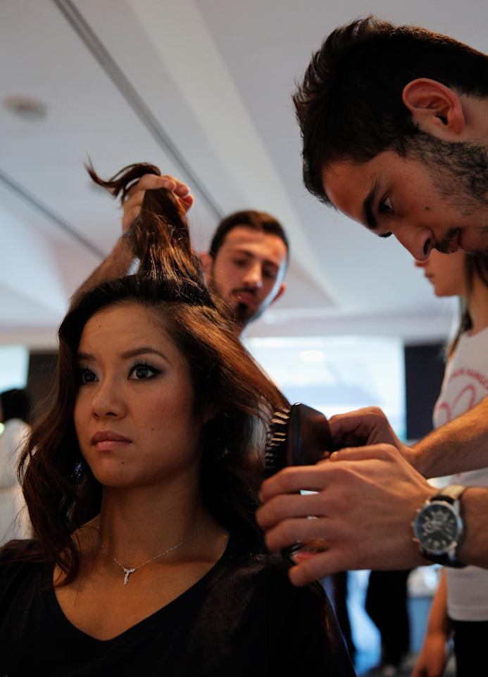 ISTANBUL, TURKEY - OCTOBER 20: Li Na of China attends the Oriflame Style Suite and has her hair done during the previews of the TEB BNP Paribas WTA Championships at the Renaissance Polat Istanbul Hotel on October 20, 2013 in Istanbul, Turkey. (Photo by Dean Mouhtaropoulos/Getty Images)
