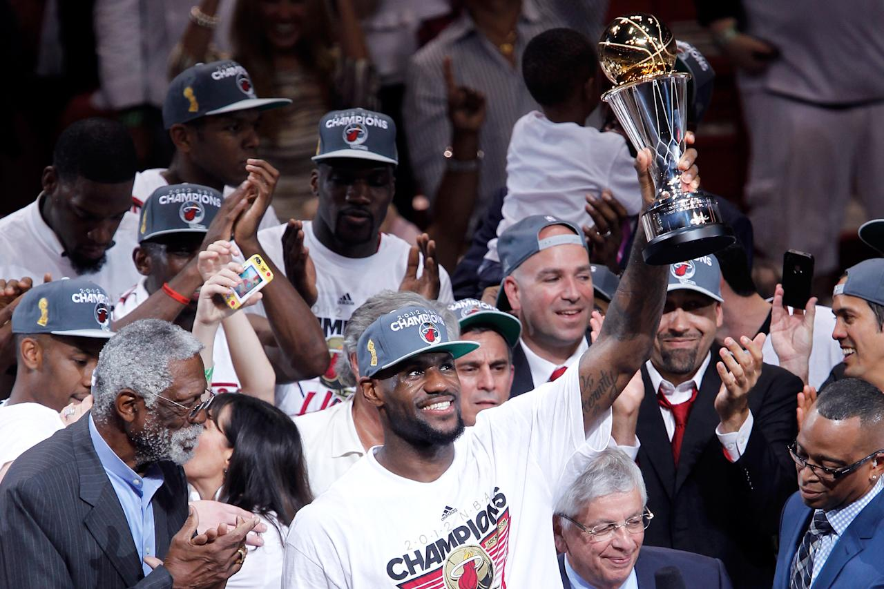 MIAMI, FL - JUNE 21:  LeBron James #6 of the Miami Heat celebrates with the Bill Russell Finals MVP trophy after they won 121-106 against the Oklahoma City Thunder in Game Five of the 2012 NBA Finals on June 21, 2012 at American Airlines Arena in Miami, Florida. NOTE TO USER: User expressly acknowledges and agrees that, by downloading and or using this photograph, User is consenting to the terms and conditions of the Getty Images License Agreement.  (Photo by Mike Ehrmann/Getty Images)