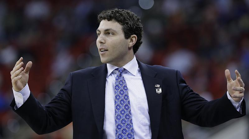 Memphis head coach Josh Pastner watches play against George Washington during the first half of an NCAA college basketball second-round tournament game, Friday, March 21, 2014, in Raleigh