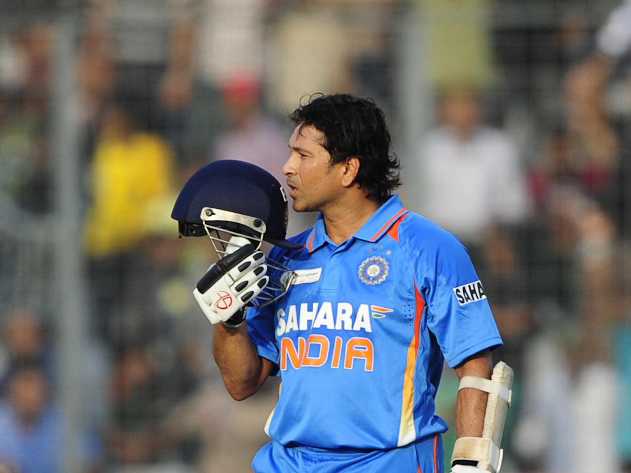 Indian batsman Sachin Tendulkar reacts after scoring his hundred century (100 runs) during the one day international (ODI) Asia Cup cricket match between India and Bangladesh at the Sher-e-Bangla National Cricket Stadium in Dhaka on March 16, 2012.  India's Sachin Tendulkar became the first batsman in history to score 100 international centuries, adding another milestone in his record-breaking career. AFP PHOTO/Munir uz ZAMAN (Photo credit should read MUNIR UZ ZAMAN/AFP/Getty Images)