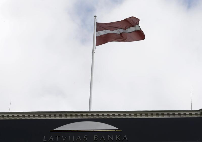 Latvia's national flag waves over the Central Bank building in Riga