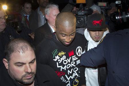 New York Knicks point guard Raymond Felton leaves Manhattan Criminal Court after his arraignment in New York