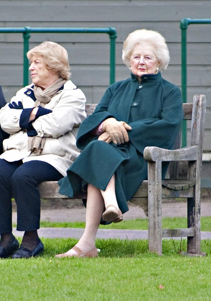 LONDON, ENGLAND - MARCH 08:  (UK PAPERS OUT FOR 24 HOURS FROM 8 APRIL 2013) Former British Prime Minister Baroness Margaret Thatcher spends an afternoon watching school children playing football in Battersea Park with her carer and housekeeper Kate (L) on March 3, 2013 in London, England.  (Photo by Antony Jones/UK Press via Getty Images)