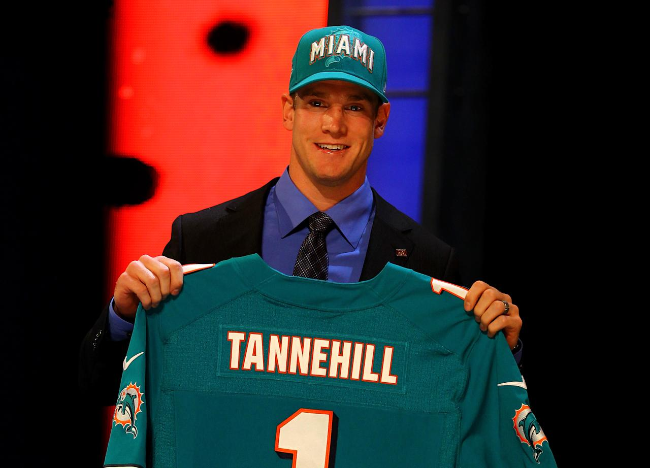 NEW YORK, NY - APRIL 26:  Ryan Tannehill from Texas A&M holds up a jersey as he stands on stage after he was selected #8 overall by the Miami Dolphins in the first round of during the 2012 NFL Draft at Radio City Music Hall on April 26, 2012 in New York City.  (Photo by Al Bello/Getty Images)