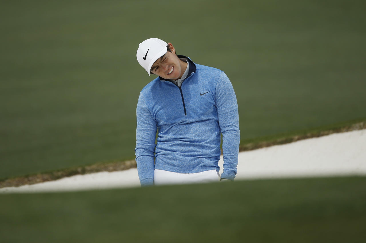 Rory McIlroy, of Northern Ireland, reacts after his shot out of a bunker on the second hole during the final round of the Masters golf tournament Sunday, April 10, 2016, in Augusta, Ga. (AP Photo/Matt Slocum)