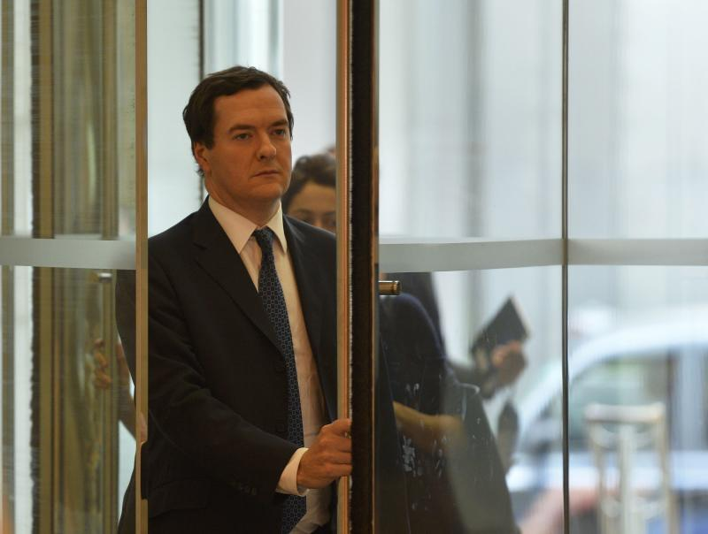 Britain's Chancellor of the Exchequer George Osborne arrives for a Thomson Reuters Newsmaker event at Canary Wharf in London