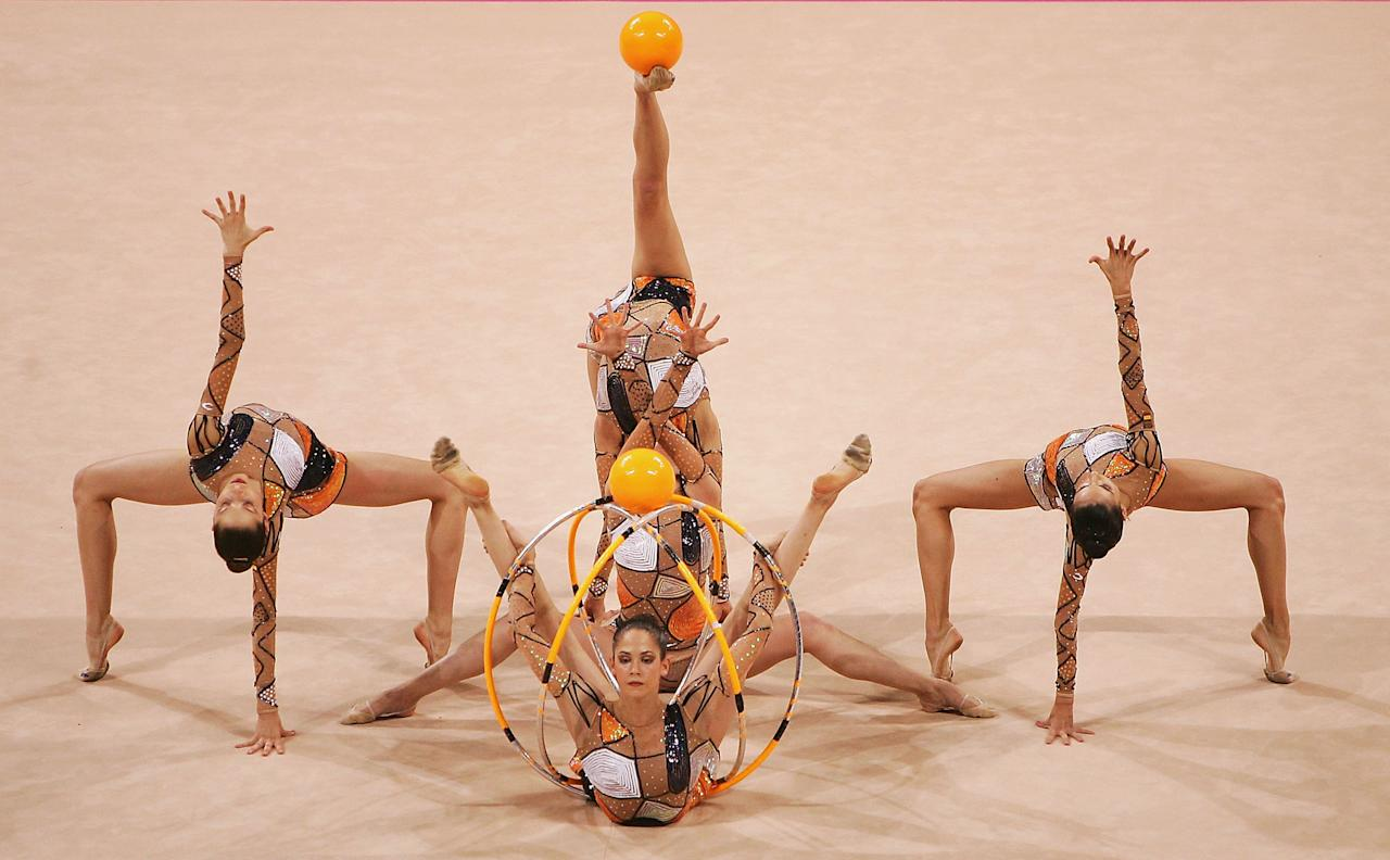 ATHENS - AUGUST 26:  Spain dances in the rhythmic gymnastics group qualifications on August 26, 2004 during the Athens 2004 Summer Olympic Games at the Galatsi Olympic Hall in Athens, Greece. (Photo by Mike Hewitt/Getty Images)