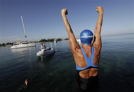 U.S. long-distance swimmer Diana Nyad cheers before attempting to swim to Florida from Havana August 31, 2013. REUTERS/Enrique De La Osa