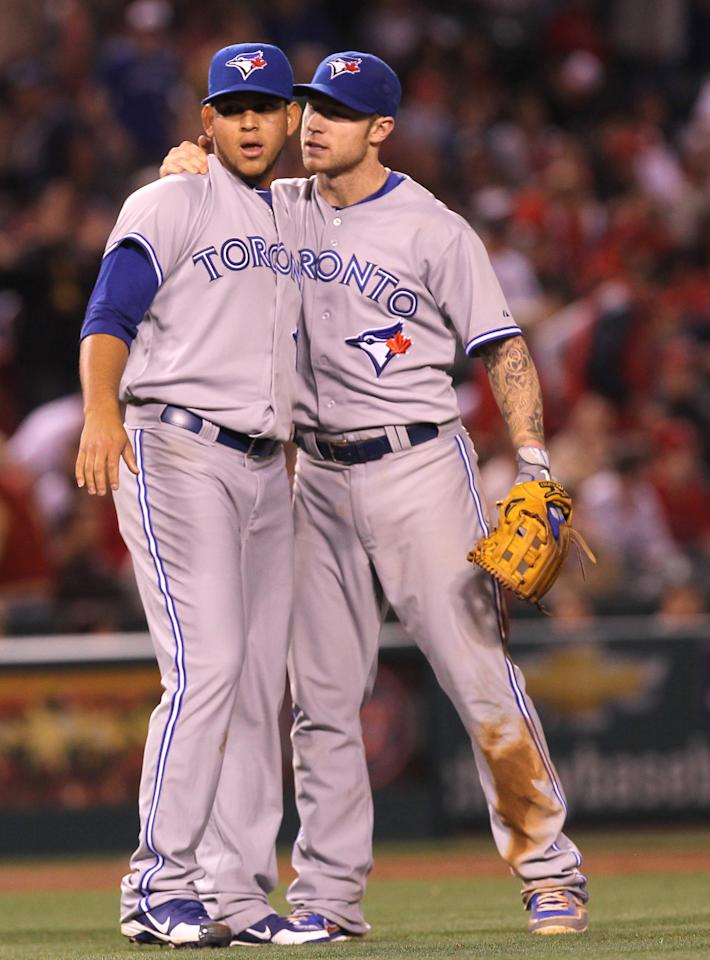 ANAHEIM, CA - MAY 04:  Starting pitcher Henderson Alvarez #37 (L) and third baseman Brett Lawrie #13 of the Toronto Blue Jays celebrate after the final out of Alvarez' complete game shutout against the Los Angeles Angels of Anaheim at Angel Stadium of Anaheim on May 4, 2012 in Anaheim, California.  The Blue Jays won 4-0.  (Photo by Stephen Dunn/Getty Images)
