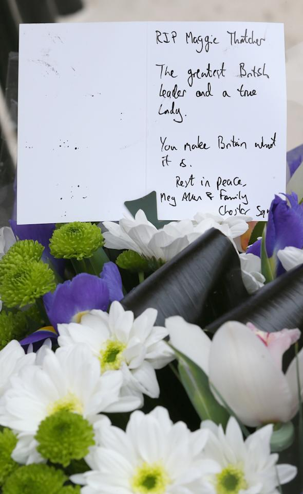 LONDON, ENGLAND - APRIL 08:  A floral tribute is left outside the residence of Baroness Thatcher in Chester Square on April 8, 2013 in London, England. Lord Bell, spokesperson for Baroness Margaret Thatcher, announced in a statement that the former British Prime Minister died peacefully following a stroke on 8th April, aged 87.  (Photo by Peter Macdiarmid/Getty Images)