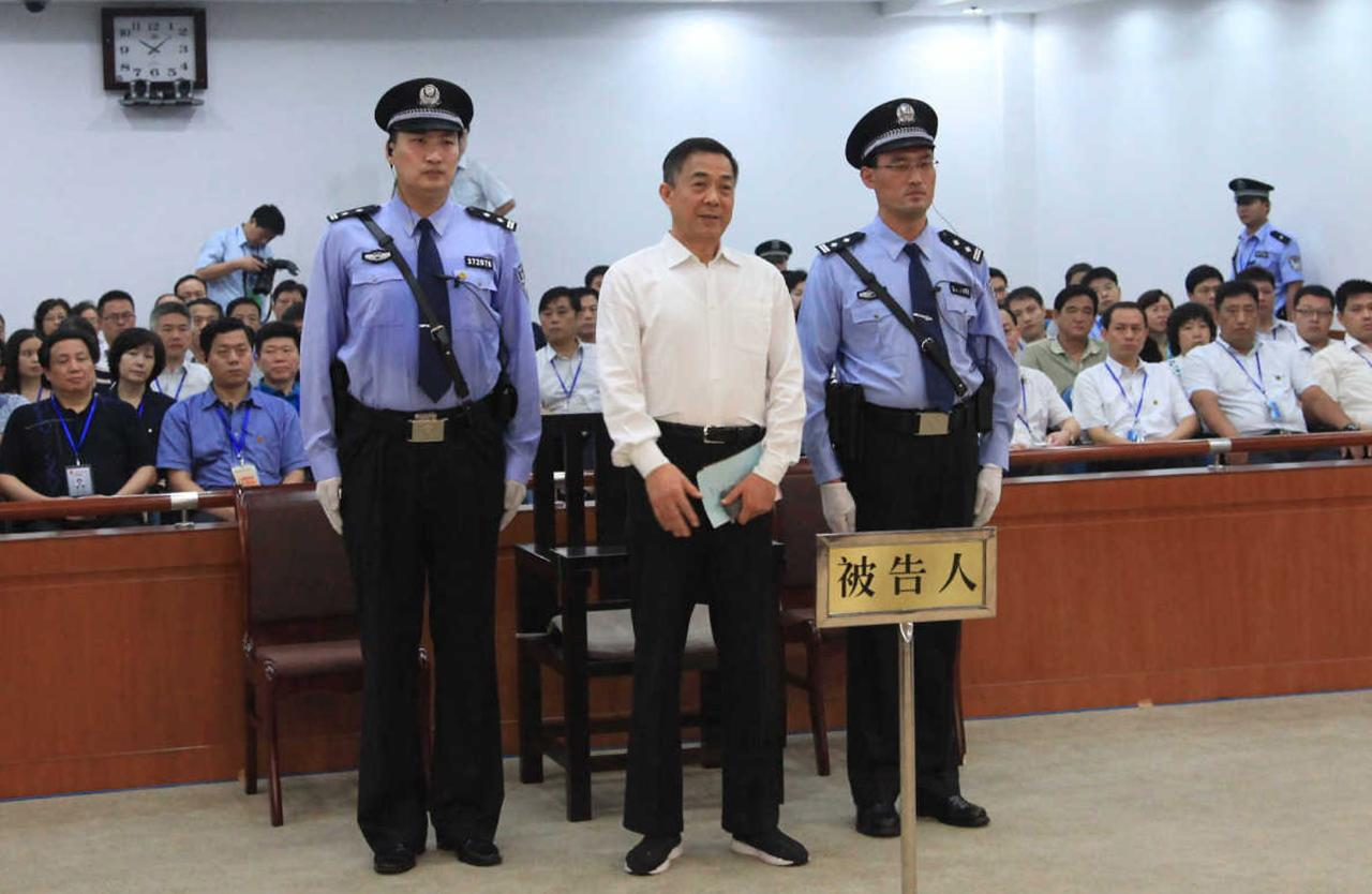 Ousted Chinese politician Bo Xilai (C) listens to his verdict inside the court in Jinan, Shandong province September 22, 2013, in this photo released by Jinan Intermediate People's Court. The court sentenced former Chongqing Municipality Communist Party Secretary Bo to life in prison on Sunday after finding him guilty of all the charges he faced of corruption, taking bribes and abuse of power. REUTERS/Jinan Intermediate People's Court/Handout via Reuters (CHINA - Tags: POLITICS CRIME LAW TPX IMAGES OF THE DAY)   ATTENTION EDITORS - THIS IMAGE HAS BEEN SUPPLIED BY A THIRD PARTY. FOR EDITORIAL USE ONLY. NOT FOR SALE FOR MARKETING OR ADVERTISING CAMPAIGNS. THIS PICTURE WAS PROCESSED BY REUTERS TO ENHANCE QUALITY. AN UNPROCESSED VERSION WILL BE PROVIDED SEPARATELY. NO SALES. NO ARCHIVES