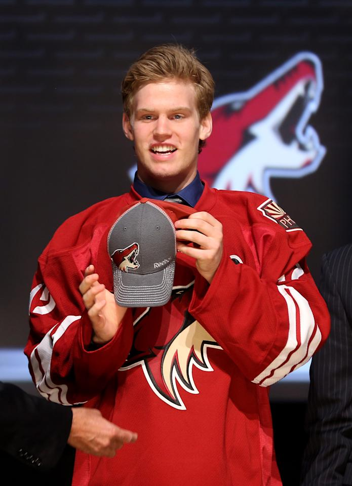 PITTSBURGH, PA - JUNE 22:  Henrik Samuelsson, 27th overall pick by the Phoenix Coyotes, poses on stage during Round One of the 2012 NHL Entry Draft at Consol Energy Center on June 22, 2012 in Pittsburgh, Pennsylvania.  (Photo by Bruce Bennett/Getty Images)