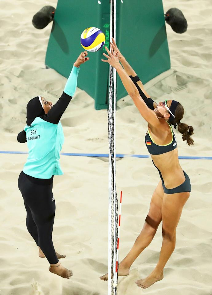 FILE PHOTO -  2016 Rio Olympics - Beach Volleyball - Women's Preliminary - Beach Volleyball Arena - Rio de Janeiro, Brazil - 07/08/2016. Doaa Elghobashy (EGY) of Egypt and Kira Walkenhorst (GER) of Germany compete.  REUTERS/Lucy Nicholson/File Photo       FOR EDITORIAL USE ONLY. NOT FOR SALE FOR MARKETING OR ADVERTISING CAMPAIGNS.                      REUTERS PICTURES OF THE YEAR 2016 - SEARCH 'POY 2016' TO FIND ALL IMAGES