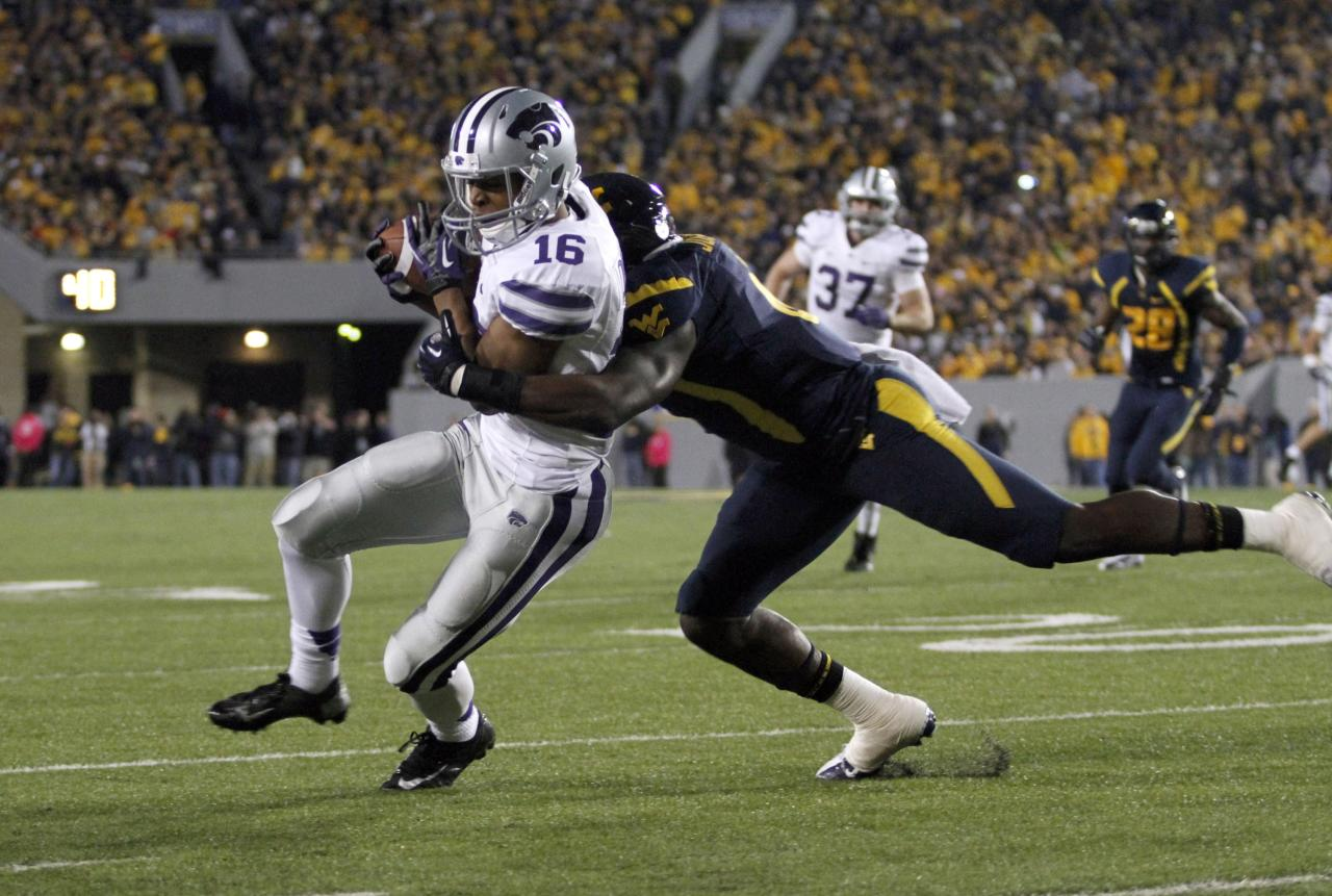 MORGANTOWN, WV - OCTOBER 20:  Tyler Lockett #16 of the Kansas State Wildcats runs after the catch against Darwin Cook #25 of the West Virginia Mountaineers during the game on October 20, 2012 at Mountaineer Field in Morgantown, West Virginia.  (Photo by Justin K. Aller/Getty Images)