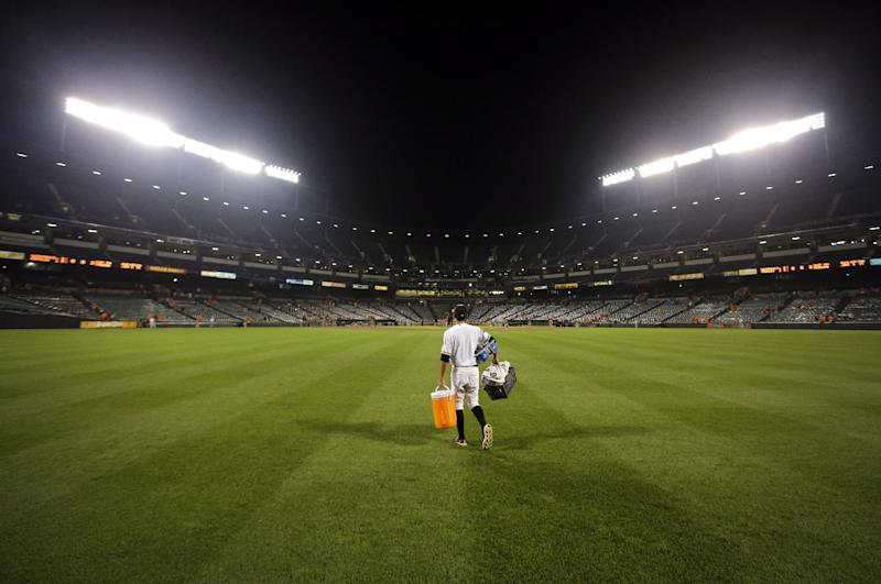 AP PHOTOS: Orioles batboy blends in with players