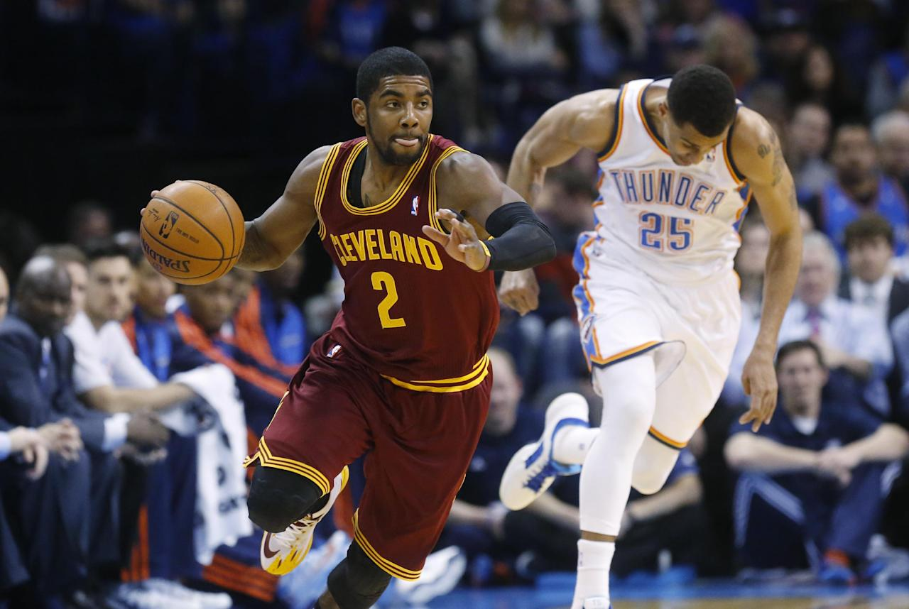 Cleveland Cavaliers guard Kyrie Irving (2) heads up the court after stealing the ball from Oklahoma City Thunder guard Thabo Sefolosha (25) in the second quarter of an NBA basketball game in Oklahoma City, Wednesday, Feb. 26, 2014. (AP Photo/Sue Ogrocki)