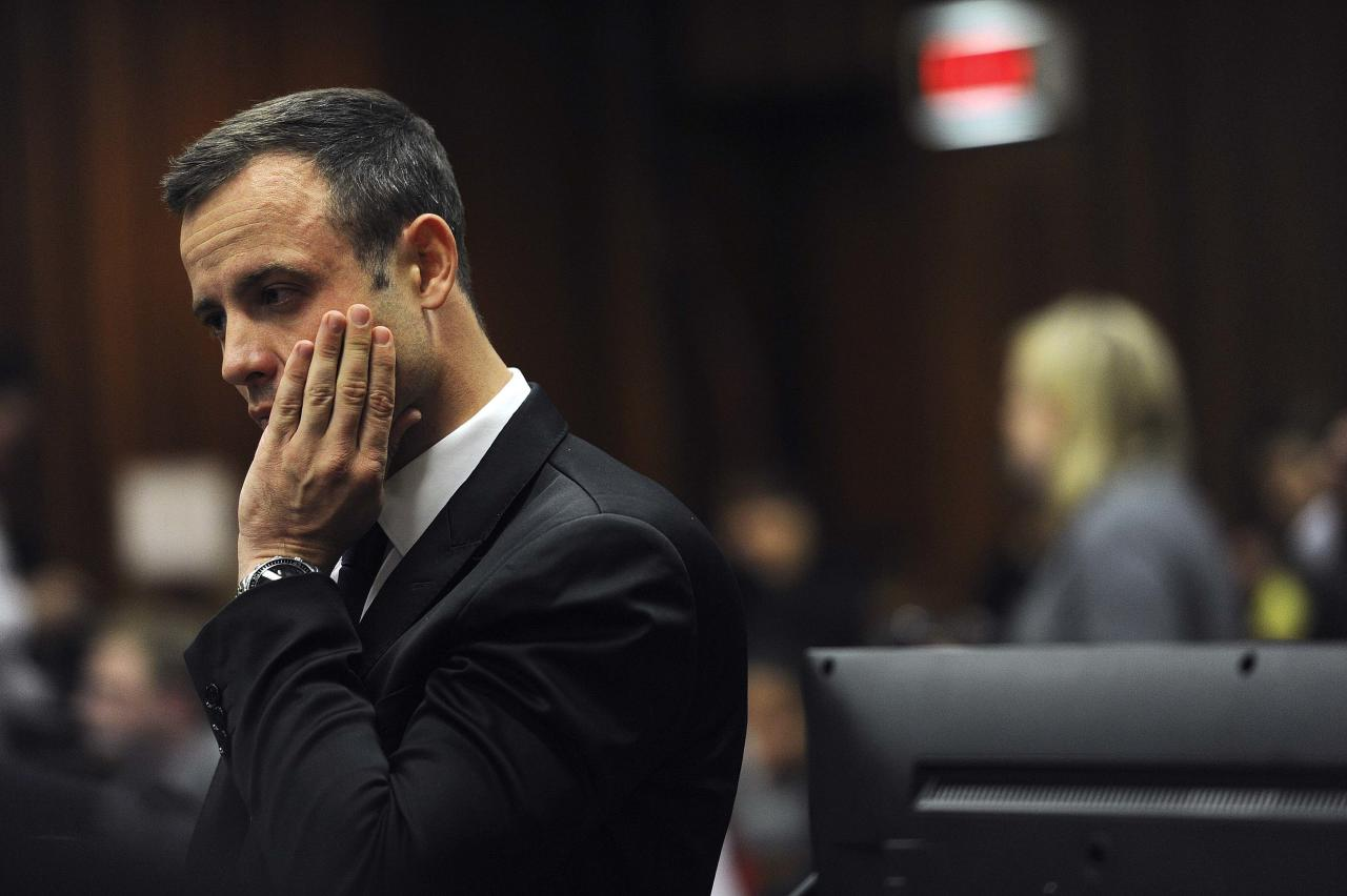 Olympic and Paralympic track star Oscar Pistorius reacts during the fourth day of his trial for the murder of his girlfriend Reeva Steenkamp at the North Gauteng High Court in Pretoria, March 6, 2014. REUTERS/Werner Beukes/Pool (SOUTH AFRICA - Tags: SPORT ATHLETICS CRIME LAW TPX IMAGES OF THE DAY)