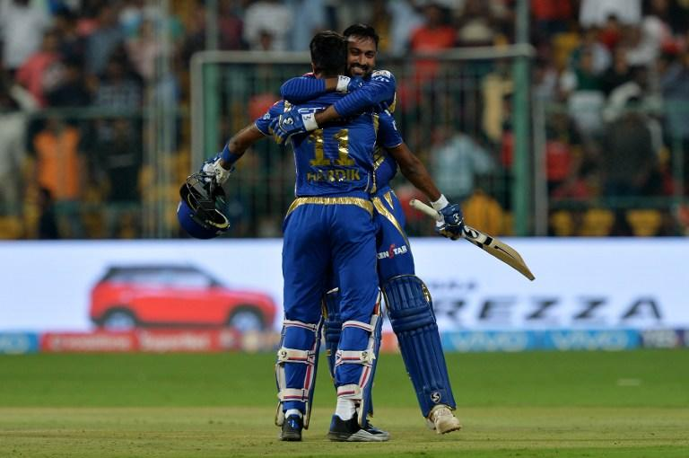 <p>Mumbai Indians batsman Krunal Pandya (R) hugs teammate Hardik Pandya as they celebrate their team's victory in the 2017 Indian Premier League (IPL) Twenty20 cricket match between Royal Challengers Bangalore and Mumbai Indians at The M.Chinnaswamy Stadium in Bangalore on April 14, 2017. ——IMAGE RESTRICTED TO EDITORIAL USE – STRICTLY NO COMMERCIAL USE—– / GETTYOUT—— / AFP PHOTO / Manjunath KIRAN / —-IMAGE RESTRICTED TO EDITORIAL USE – STRICTLY NO COMMERCIAL USE—– / GETTYOUT </p>