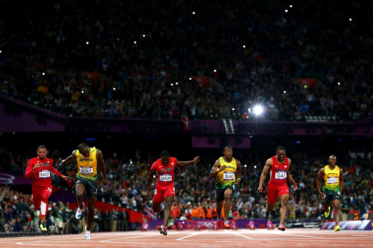 LONDON, ENGLAND - AUGUST 05:  Usain Bolt of Jamaica crosses the finish line ahead of Ryan Bailey of the United States, Yohan Blake of Jamaica and Justin Gatlin of the United States to win the Men's 100m Final on Day 9 of the London 2012 Olympic Games at the Olympic Stadium on August 5, 2012 in London, England.  (Photo by Michael Steele/Getty Images)
