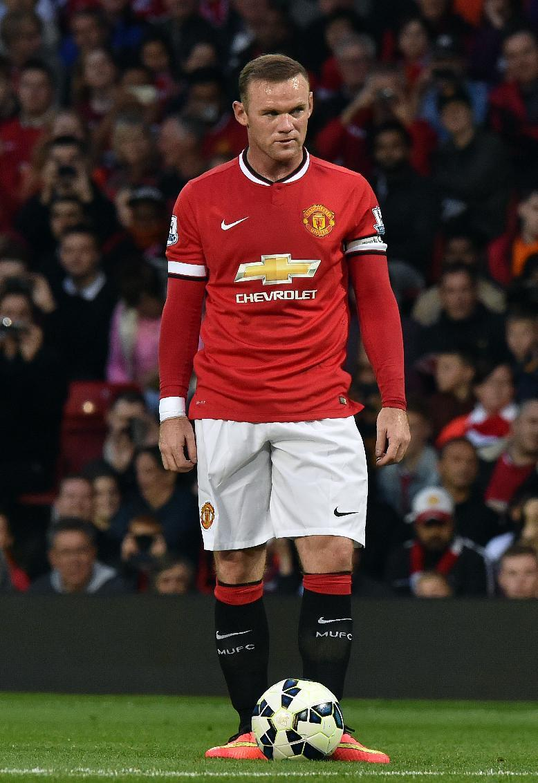 Manchester United's English striker Wayne Rooney prepares to take a free kick during the pre-season football friendly match between Manchester United and Valencia at Old Trafford on August 12, 2014